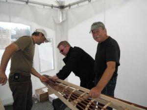 Wolfgang Brinck, building kayak at 2011 camp